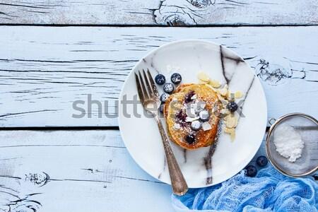 áfonya házi készítésű palacsinták tányér finom méz Stock fotó © YuliyaGontar