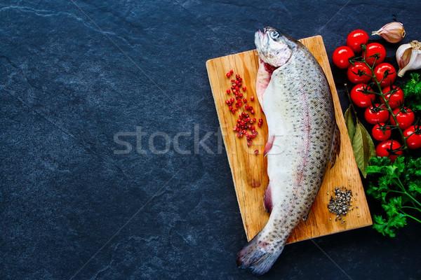 Fish with ingredients Stock photo © YuliyaGontar