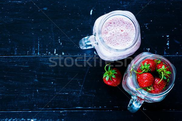 Piros eper smoothie üveg bögre felszolgált Stock fotó © YuliyaGontar
