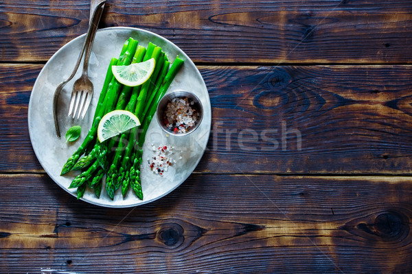 Cooked asparagus on plate Stock photo © YuliyaGontar