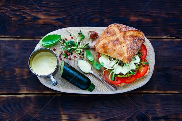 Finom vegan hamburger ízletes cukkini paradicsomok Stock fotó © YuliyaGontar
