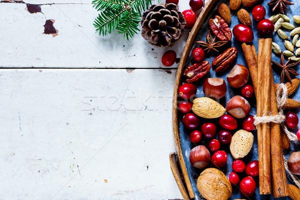 Természetes karácsony dekoráció diók áfonya fűszer Stock fotó © YuliyaGontar