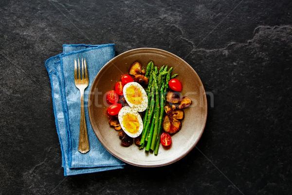 Aspargus and egg on plate Stock photo © YuliyaGontar
