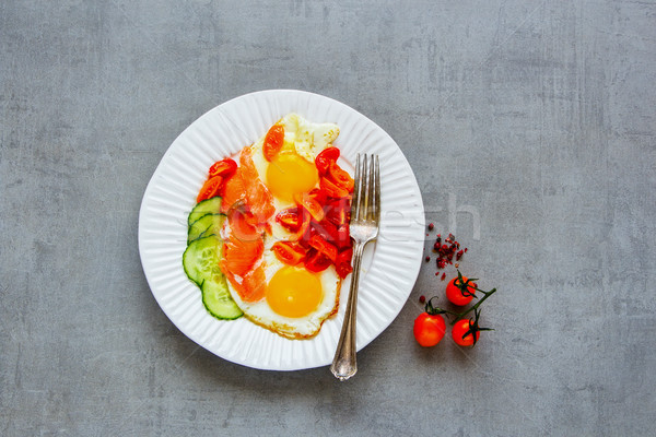 Breakfast with salmon and fried eggs Stock photo © YuliyaGontar