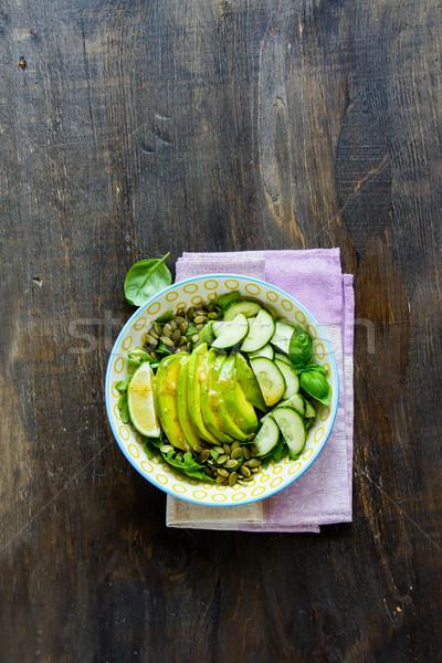 вегетарианский зеленый Салат лет салатницу огурцы Сток-фото © YuliyaGontar