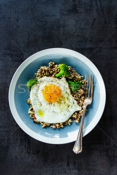 Quinoa, broccoli and egg bowl Stock photo © YuliyaGontar