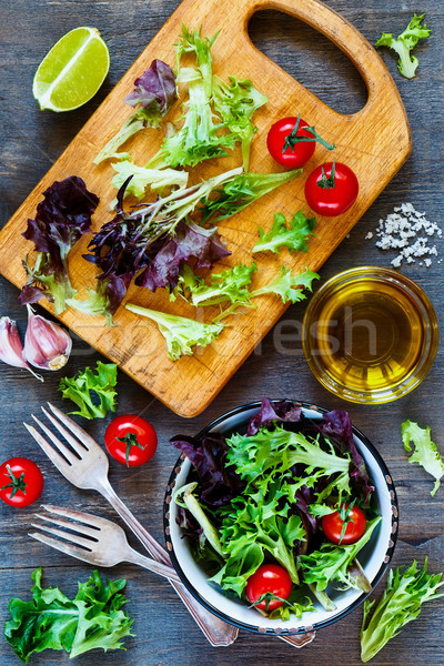 Healthy salad on cutting board Stock photo © YuliyaGontar