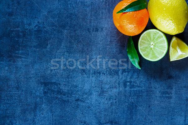 Zdjęcia stock: Cytrus · owoce · pozostawia · ciemne · vintage