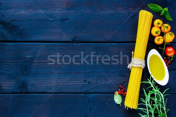 Spagetti malzemeler biberiye fesleğen domates zeytinyağı Stok fotoğraf © YuliyaGontar