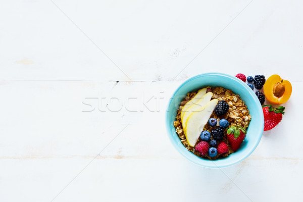 Bowl of homemade granola Stock photo © YuliyaGontar