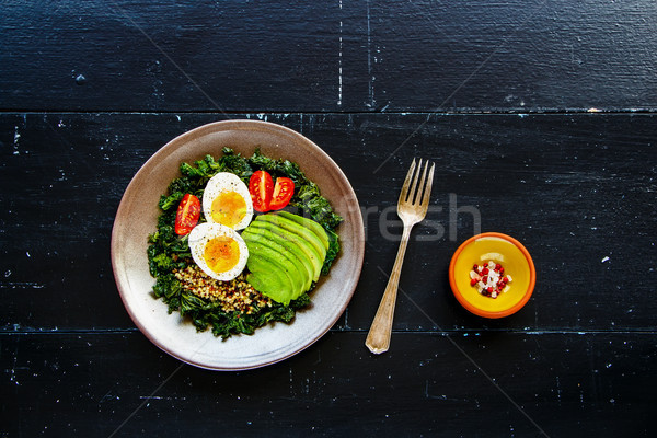 Quinoa, kale and egg bowl Stock photo © YuliyaGontar