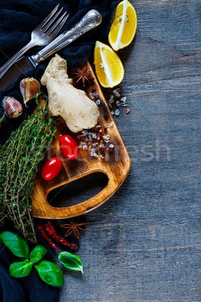 Gyógynövények fűszer konyhaasztal friss öreg fa deszka Stock fotó © YuliyaGontar