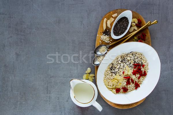 Organikus pelyhek egészséges reggeli hozzávalók tej Stock fotó © YuliyaGontar