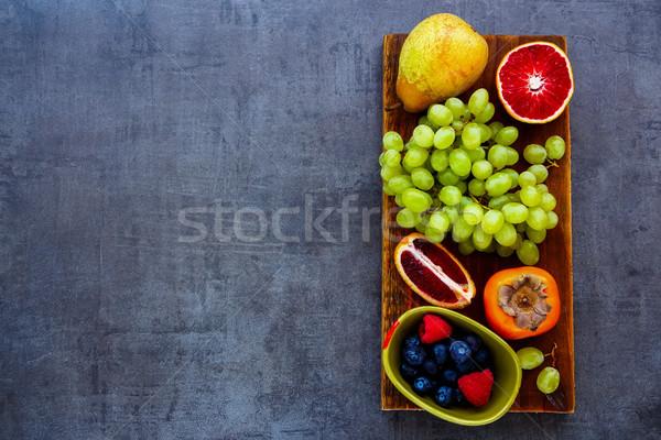 オーガニック フルーツ 素朴な 木製 まな板 ストックフォト © YuliyaGontar