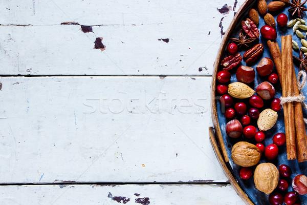 Nüsse Preiselbeeren Gewürze alten rostigen Eisen Stock foto © YuliyaGontar