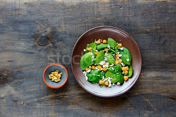 Salad with spinach leaves Stock photo © YuliyaGontar
