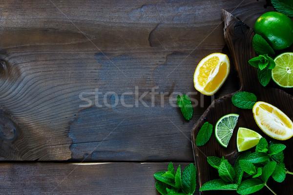 Citrus citromok menta felső kilátás szeletel Stock fotó © YuliyaGontar