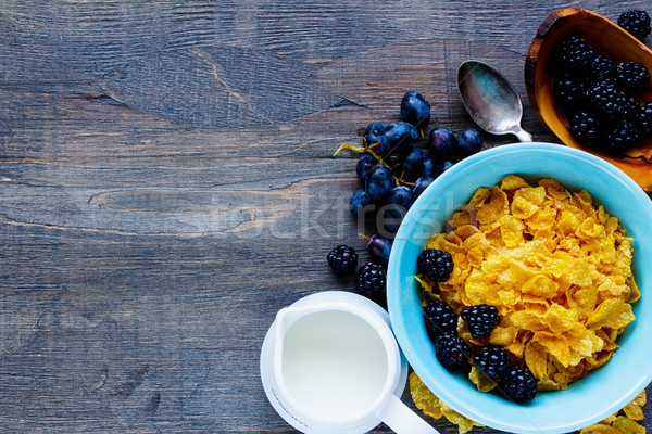 Tál gabonapehely ízletes reggeli asztal tej Stock fotó © YuliyaGontar