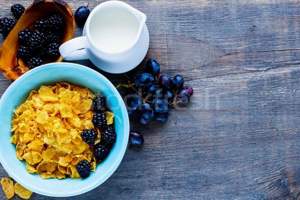 Kom cornflakes kleurrijk ontbijt tabel melk Stockfoto © YuliyaGontar