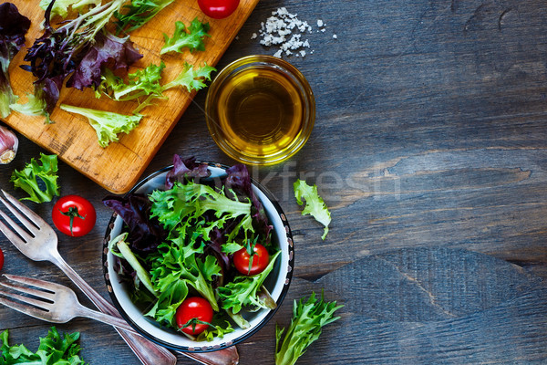 Stock photo: Healthy salad on cutting board
