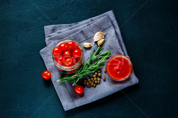 Cooking cherry tomato sauce Stock photo © YuliyaGontar