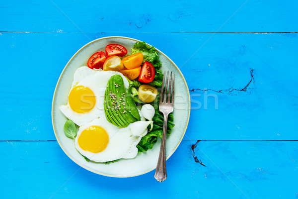 Fried eggs and vegetables Stock photo © YuliyaGontar