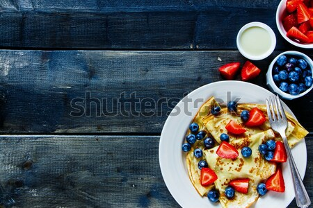 Crepes with berries. Stock photo © YuliyaGontar