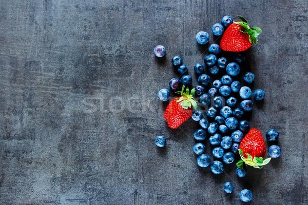Berries on dark vintage background Stock photo © YuliyaGontar