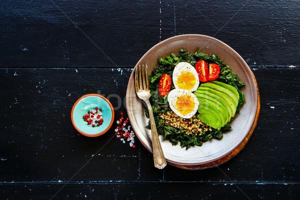 Quinoa, kale and egg bowl Stock photo © YuliyaGontar