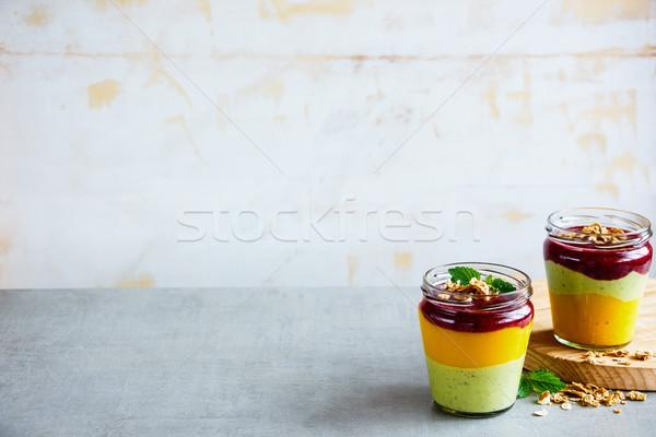 Fruit layered smoothie Stock photo © YuliyaGontar