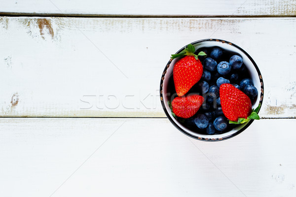 Ceramic bowl with berries Stock photo © YuliyaGontar