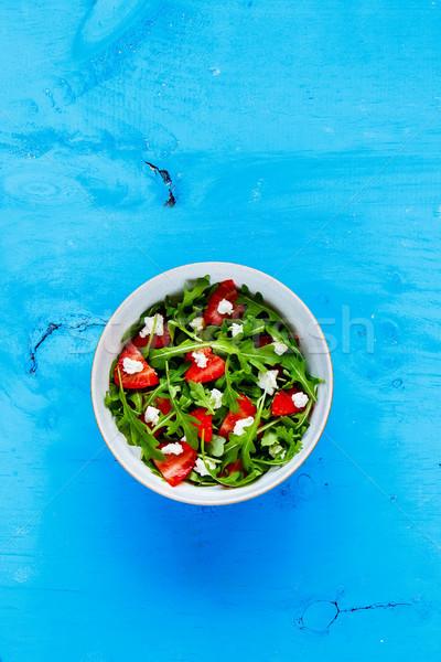 Strawberry arugula feta cheese salad Stock photo © YuliyaGontar