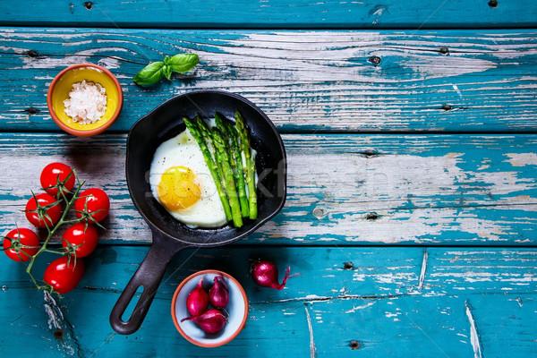 Fried eggs with aspargus Stock photo © YuliyaGontar