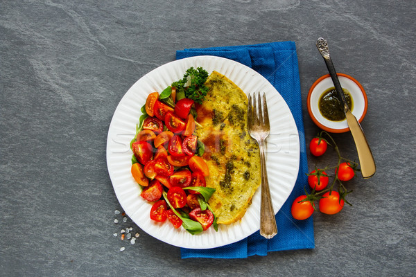 Omelette with arugula and tomatoes salad Stock photo © YuliyaGontar