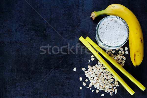 Banana smoothie with oat flakes Stock photo © YuliyaGontar