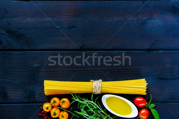 Spaghetti ingredienti fresche rosmarino basilico pomodoro Foto d'archivio © YuliyaGontar