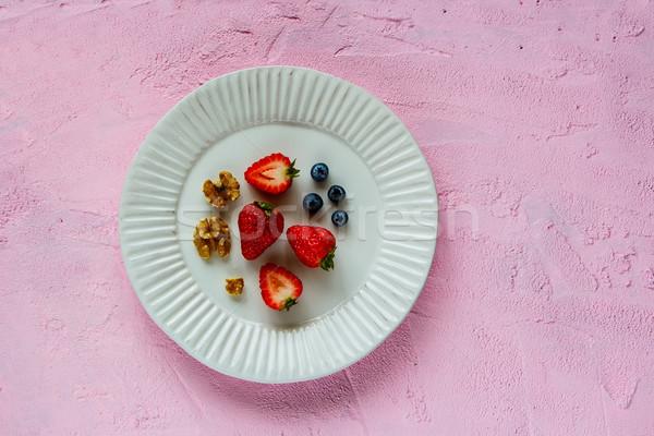 Walnut, strawberry and bluebbery Stock photo © YuliyaGontar