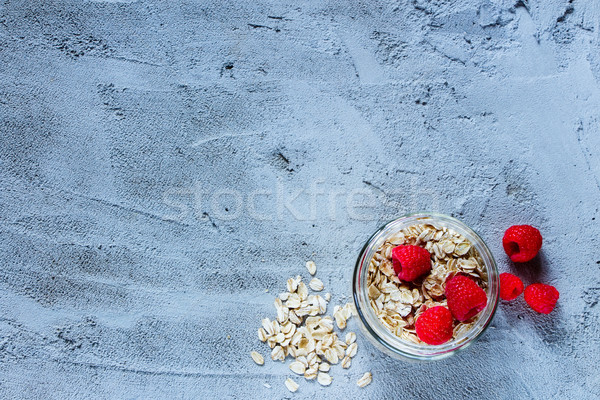 Oat flakes and raspberries Stock photo © YuliyaGontar