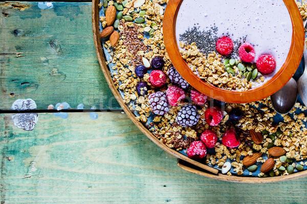 Wooden bowl of smoothie Stock photo © YuliyaGontar
