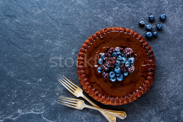 Chocolate cake with berries Stock photo © YuliyaGontar