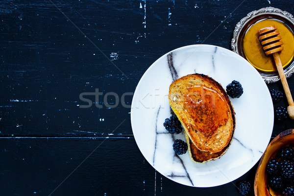 Toasts with honey and blackberries Stock photo © YuliyaGontar