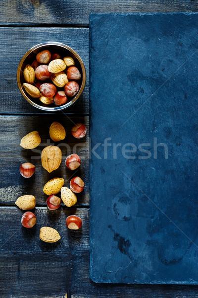 Diók válogatás mandulák mogyoró sötét fából készült Stock fotó © YuliyaGontar