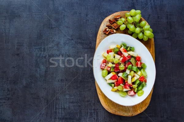 Mixte salade de fruits fraîches noix semences blanche Photo stock © YuliyaGontar