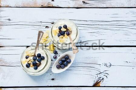Mason jars of yogurt Stock photo © YuliyaGontar