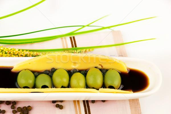 Zöld olajbogyók mártás kerámia tányér étel Stock fotó © yura_fx