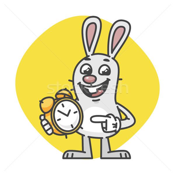 Rabbit Smiling Indicates on Alarm Clock Stock photo © yuriytsirkunov