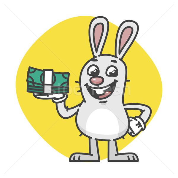 Bunny laughing and holding cash Stock photo © yuriytsirkunov