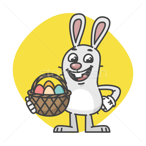 Easter Bunny Laughs and Holds Basket with Eggs Stock photo © yuriytsirkunov