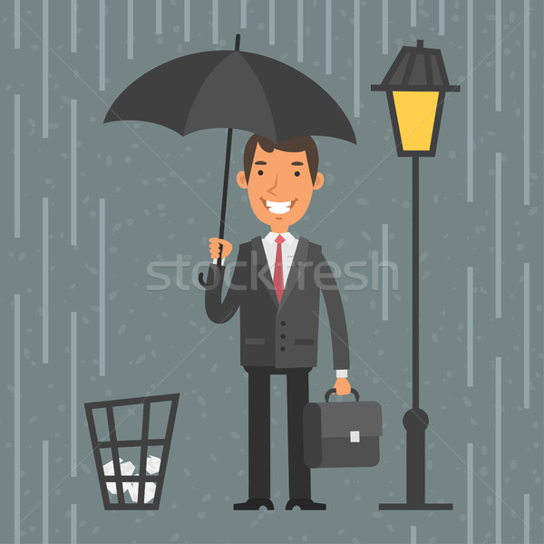 Businessman standing with umbrella in rain Stock photo © yuriytsirkunov