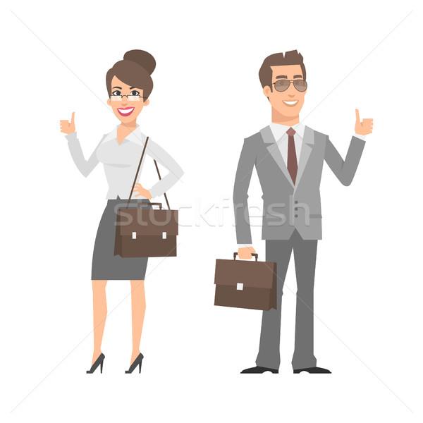 Businessman and businesswoman showing thumbs up Stock photo © yuriytsirkunov